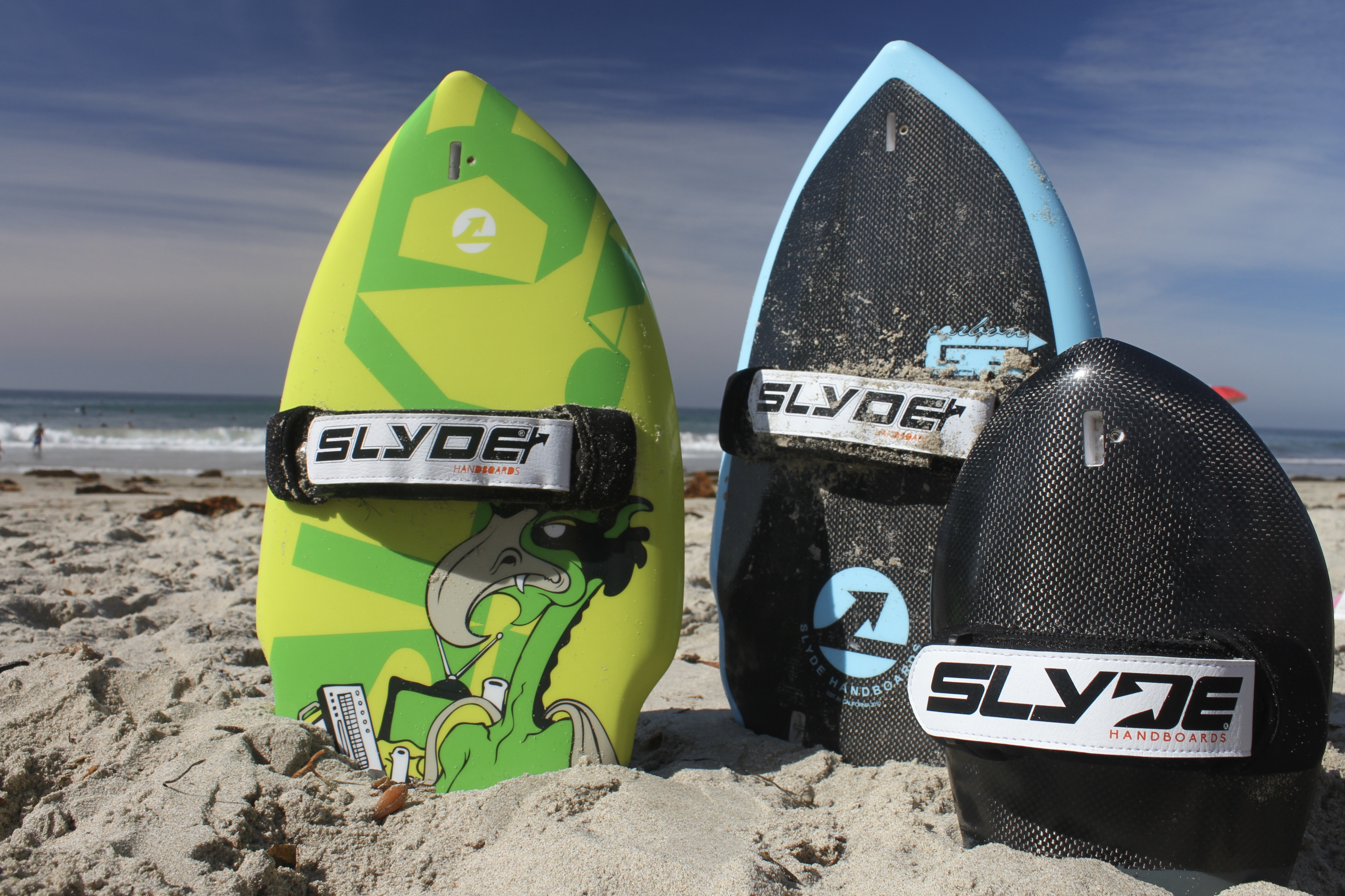 Pictured are The Wedge, The Wedge featuring a carbon fiber deck and The Bula