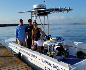 Two Shark Lab grad students prepare for an expedition with Dr. Chris Lowe.