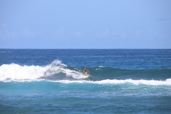 I played nice and the locals played nice back. Reaping the rewards. Photo: Kona Surf Photos