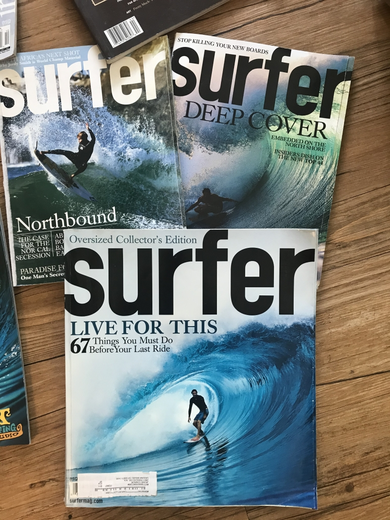 Surfer Magazine covers, man surfing green water waves, black text, man getting barreled