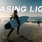 Chasing-Light-SoCal-Woman-Surfer-Running-to-the-water-with-surfboard