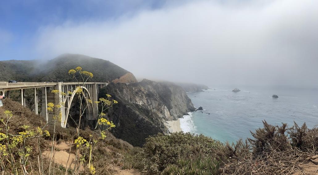 Bixby Bridge in Big Sur California with fog and the beach