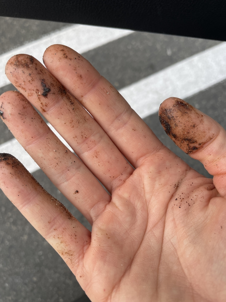 hand with tar on it